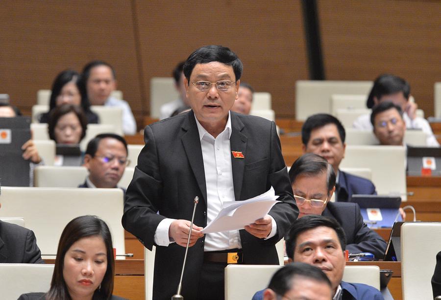 Đại biểu Quốc hội tranh luận quyết liệt về việc tách 2 luật giao thông đường bộ - Ảnh 1.