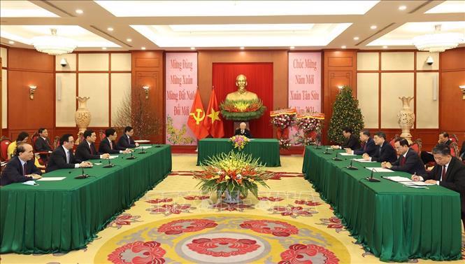 Tổng Bí thư, Chủ tịch nước Nguyễn Phú Trọng điện đàm với lãnh đạo Lào - Ảnh 1.