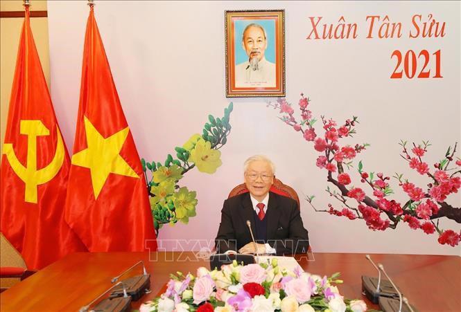 Tổng Bí thư, Chủ tịch nước Nguyễn Phú Trọng mời tân Tổng Bí thư Lào sang thăm Việt Nam - Ảnh 1.