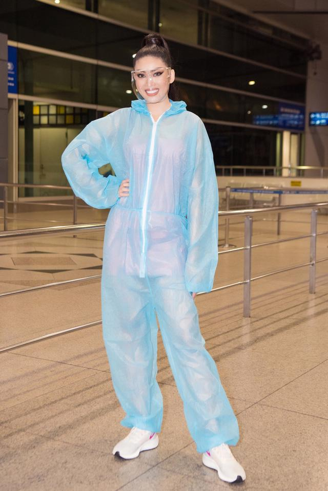 Á hậu Ngọc Thảo mặc đồ bảo hộ, lên đường dự thi quốc tế - Ảnh 1.