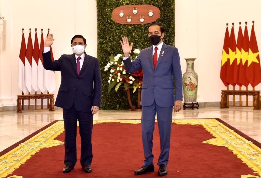 Thủ tướng Phạm Minh Chính và Tổng thống Indonesia Joko Widodo- Ảnh: VGP