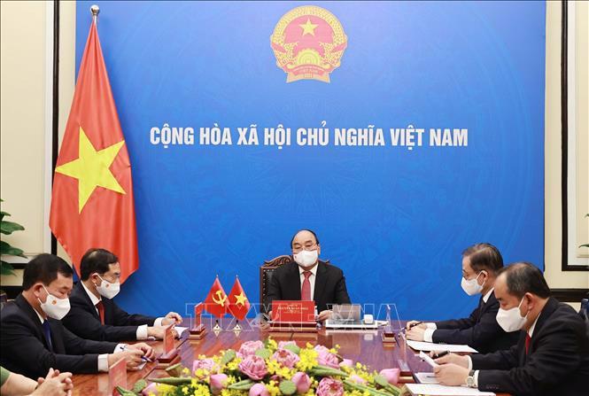 Chủ tịch nước Nguyễn Xuân Phúc: Việt Nam coi trọng phát triển quan hệ láng giềng hữu nghị, đối tác hợp tác chiến lược toàn diện với Trung Quốc - Ảnh TTXVN