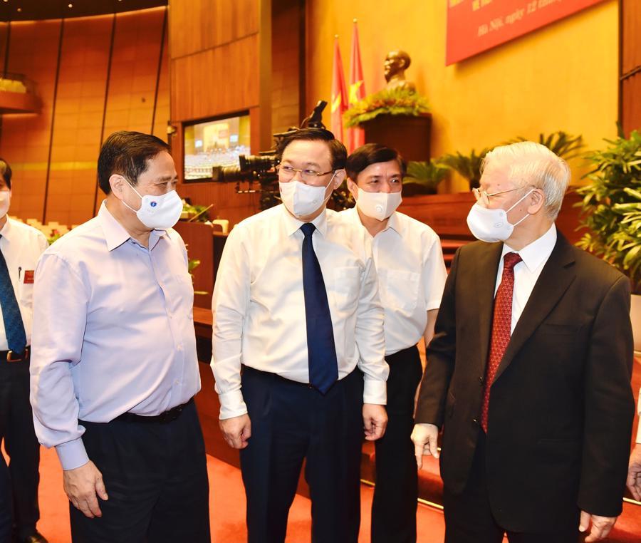 Tổng Bí thư Nguyễn Phú Trọng, Thủ tướng Chính phủ Phạm Minh Chính, Chủ tịch Quốc hội Vương Đình Huệ tại hội nghị - Ảnh: VGP/Nhật Bắc