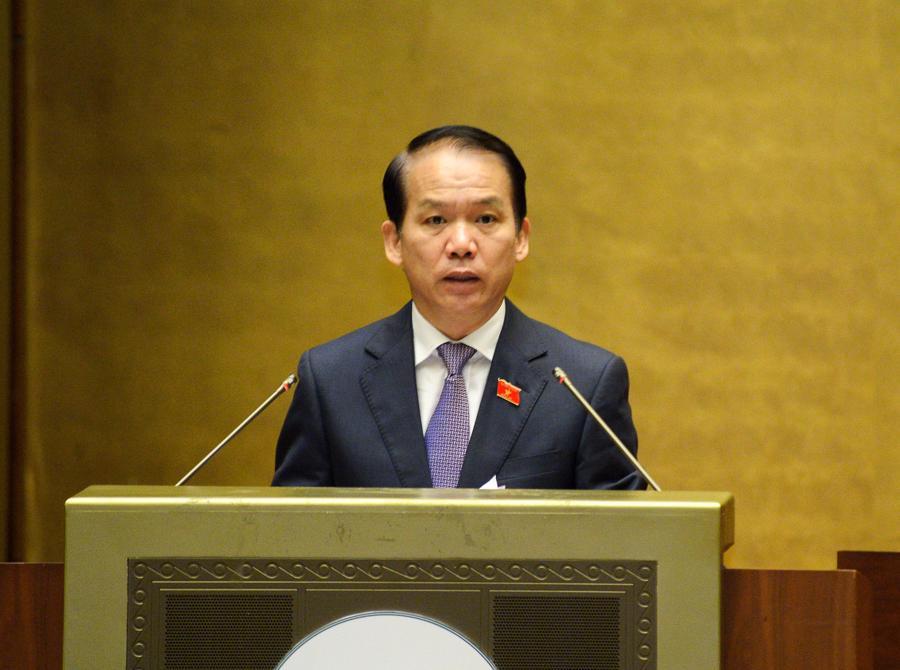 Chủ nhiệm Ủy ban Phápluật của Quốc hội Hoàng Thanh Tùng trình bày Báo cáo thẩm travề cơ cấu tổ chức của Chính phủnhiệm kỳ Quốc hội khóa XV - Ảnh: Quochoi.vn