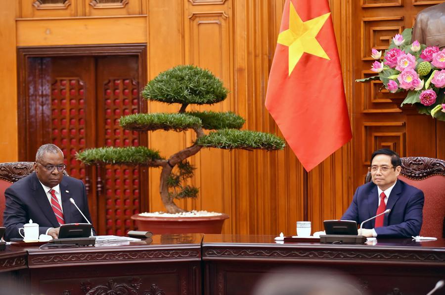 Thủ tướng Phạm Minh Chính vàBộ trưởng Quốc phòng Mỹ Lloyd Austin - Ảnh: VGP.