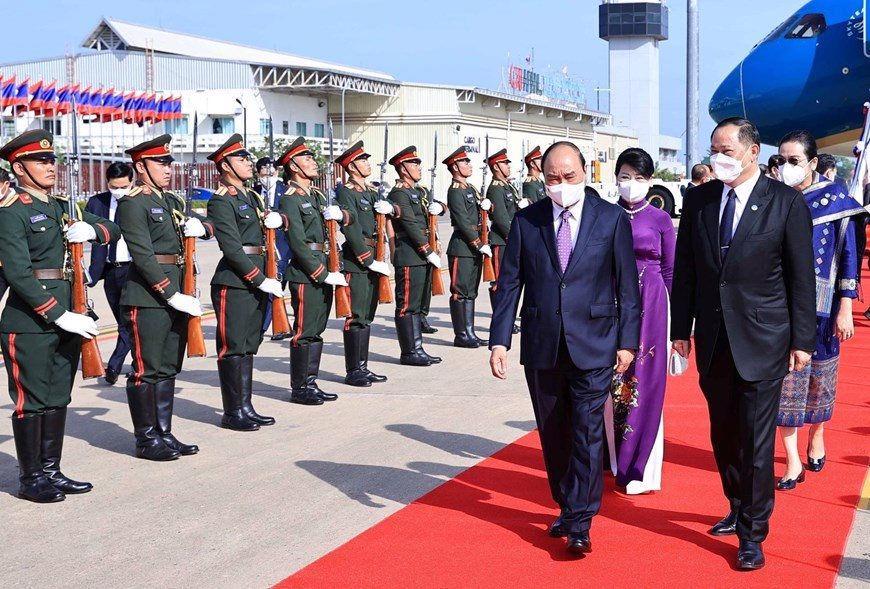 Chủ tịch nước Nguyễn Xuân Phúc thăm hữu nghị chính thức Lào - Ảnh 2