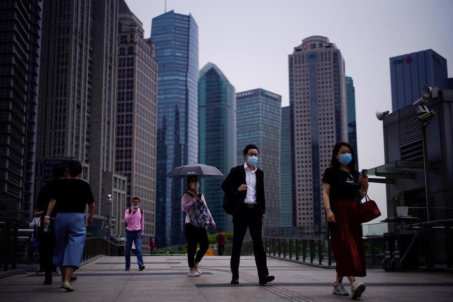 Tăng trưởng GDP thực của Trung Quốc được dự báo đạt 8,5% trong năm 2021, và giảm xuống 5,2% trong năm 2022 - Ảnh: AP