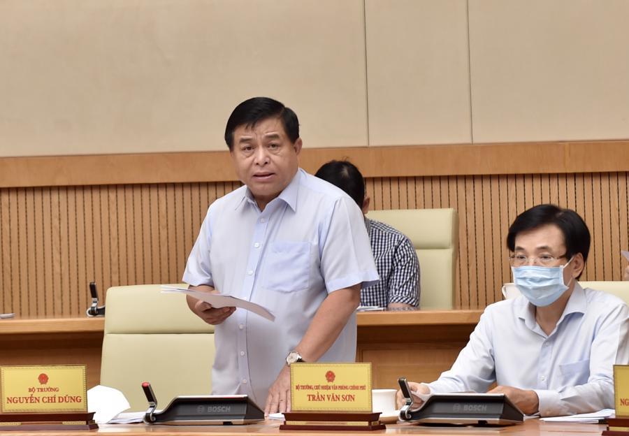Bộ trưởng Bộ Kế hoạch và Đầu tư Nguyễn Chí Dũng báo cáo về tình hình triển khai thực hiện Luật Quy hoạch - Ảnh: VGP/Nhật Bắc
