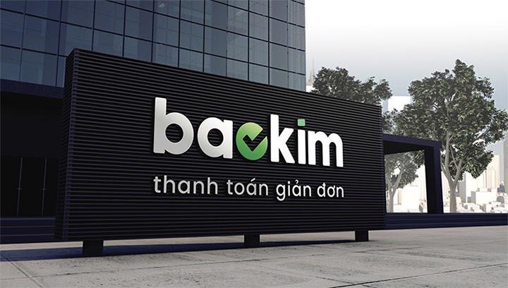 Phiên bản logo của Baokim trên nền vật liệu tối màu. Nguồn: Baokim.