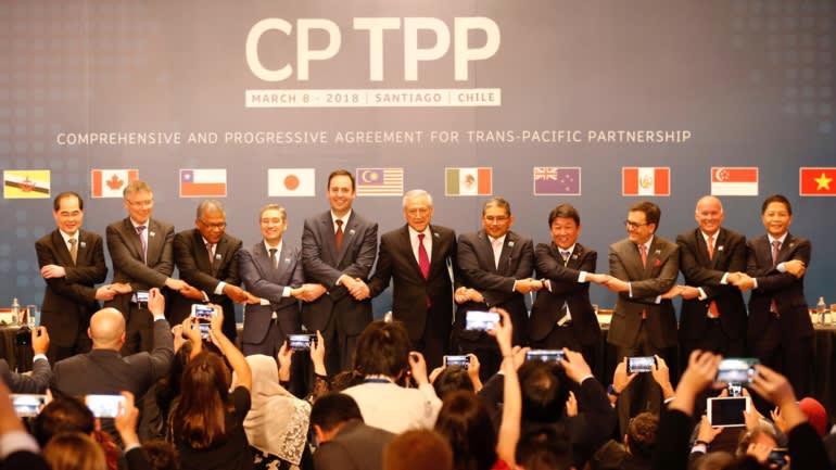 Đại diện các nước thành viên CPTPP ký kết hiệp định vào ngày 8/3/2018 tại thành phố Sanpo, Chile - Ảnh: Reuters