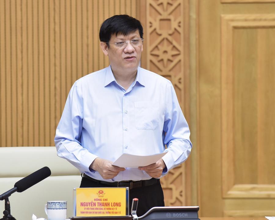 Bộ trưởng Y tế Nguyễn Thanh Long báo cáo tại cuộc họp - Ảnh: VGP