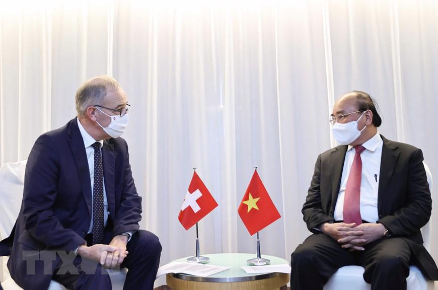 Chủ tịch nước Nguyễn Xuân Phúc tiếpTổng thống Thụy Sỹ Guy Parmelin - Ảnh: TTXVN